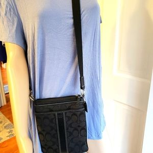 Coach Signature black pre-used crossbody